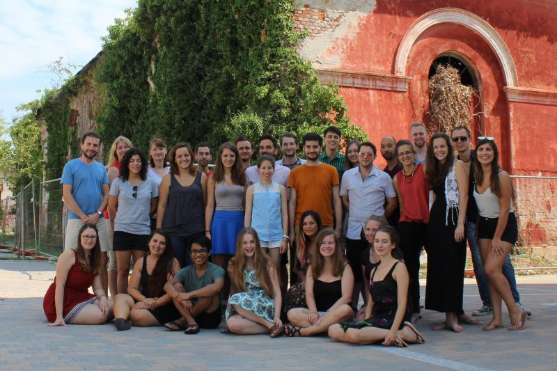 Participants of Eduk8 Novara in front of old building with terracotta-coloured walls