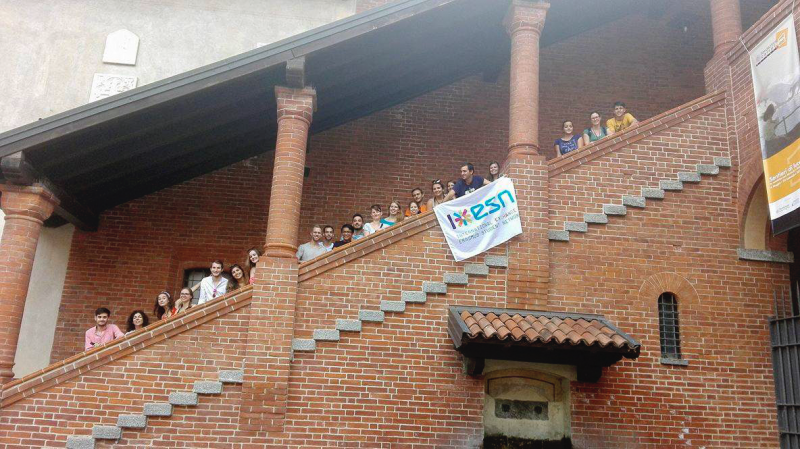 Participants of Eduk8 Novara standing on the staircase of an old brick building